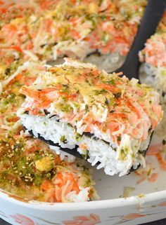 "This is a Sushi Bake! It's basically the best parts of a giant California roll made 100x larger and requires no special sushi chef skills! This ""casserole"" is filled with a mouth-watering mayo/crab meat mixture, rice, nori, and topped with a yummy and simple spicy mayo sauce!"