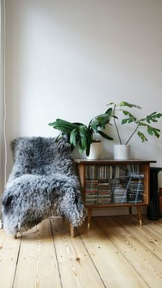 Cozy Nook with fur shearling chair and plants | boho interiors | bohemian design