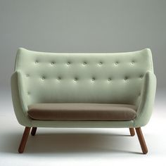 """Trans from Danish """"Finn Juhl fine little two-seater sofa from 1941 was nicknamed poet and Lillemor after the comic of the same name. The comic was made into a film in 1959 and was part Finn Juhl's furniture in scenography. www.onecollection.com"""