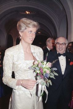 On her first official visit to New York in February 1989, Diana dressed like a fairy-tale princess in a beaded and embroidered ivory duchesse satin gown and bolero by English designer Victor Edelstein...