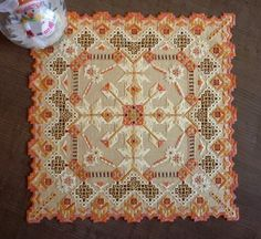 Beautiful pattern in autumn colors in a table doily