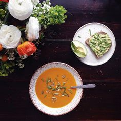 Enjoying a quiet lunch with my immune boosting Carrot Orange Ginger Soup and a side of avocado toast. Photo bomb by my floral arrangement I made last night at Fleurs & Fizz @12thtable | recipe on NS | with McKel of Nutrition Stripped