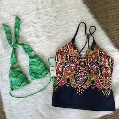 Bundle lot 2 swim suit tops size large lg athleta Two swimming tops - one price. Both size large. Green bikini top- NWT. New with tags. Old Navy. Size large. I've sewn in bra cups but could easily be undone. Never worn excellent condition.  Paisley top- great condition.  Some signs of wear.  Size large. I've sewn in bra cups but could easily be undone. I also stitched it slightly so it wouldn't be such a deep v (trying to minimize the amount of Clevage shown). This could also be undone.  I…