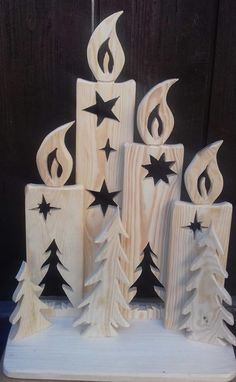 Beautiful stand with four wooden candles for self-decoration. Liebev - Chritmas - Beautiful stand with four wooden candles for self-decoration. Wooden Christmas Decorations, Christmas Wood Crafts, Rustic Christmas, Christmas Art, Christmas Projects, Holiday Crafts, Christmas Ornaments, Spring Crafts, Wooden Crafts