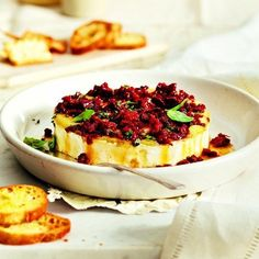 baked brie with garlic | Baked brie with sun-dried tomatoes and basil recipe - Chatelaine.com
