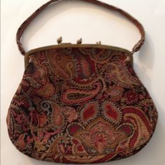 Vintage Tapestry Purse  This fabulous purse has 3 separate compartments! There is some discoloration inside (lining) and price reflects that. There is an attached vintage mirror and tiny pocket (for a key or lipstick). For a vintage lover, this bag holds more than most. The exterior tapestry is in good condition. No tears inside or out. The bag measures 11 inches wide, 9 inches long, 6 inch handle. Vintage Bags