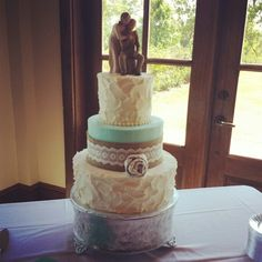 Rustic chic wedding country wedding with tiffany blue tier. Spoon swirl pattern on top and bottom tiers.  Bride provided ribbon.  Cream cheese pound cake.