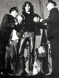 "Jim Morrison being arrested, supposedly for ""indecent exposure"".(1970s)"