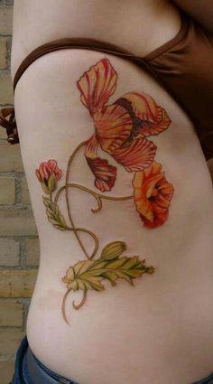 Orange flower tattoo