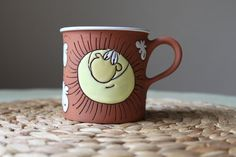 Tea cup - smiling sun in the sky. via Etsy.