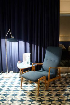 Inside the room there is a great reading chair and light at the Parco dei Principe, Sorrento
