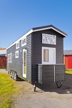 The home measures 310 sq ft between its ground floor and two lofts. It also comes with a small porch in the back that can be folded against the home for transport. There's also a full kitchen, bathroom that doubles as a laundry room, dining space, a comfy living room and two loft spaces.
