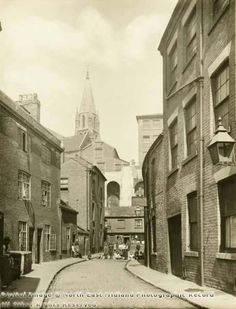 The spire of the High Pavement Chapel can be seen in the background. Local History, Family History, Nottingham City Centre, Day And Time, History Photos, Slums, Pavement, Time Travel, Old Photos
