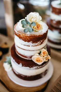 Naked wedding cakes are having a major moment! Top it with subtle flowers for an extra rustic look.