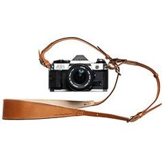 Naturally dyed leather camera strap from Leather Factory Roberu. Made using 100-percent cow's hide steeped in vegetable tannins. A paradigm of comfort a...