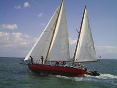 This cutter-rigged ketch is Joshua.  She was named after Joshua Slocum by Bernard Moitessier.  She might have been the first boat to ever non-stop circumnavigate the Earth.  However, Bernard left the race, and continued sailing half-way around the world again, leaving that first race to Robin Knox-Johnston.