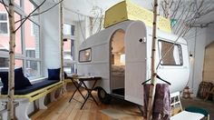 Huettenpalast, Berlin, Germany. A unique bed and breakfast of Caravan and Wooden hut bedrooms in former factory.