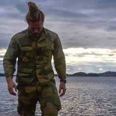 This sultry soldier, Lasse L. Matberg, totally rocked the Man Bun!
