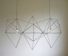 Prism by Nathalie Dewez for Habitat | don't bother, it's out of production. why the hell didn't I buy it when i first saw it — years ago, before i had a place to put it?! powder-coated steel. my all-time favorite geometric chandy. *sadface* HABITAT: PLZ MAKE THIS AGAIN!