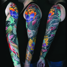 A very beautiful colorful floral tattoo done by Sean McCready, tattoo artist and owner of TattooLiciousHi