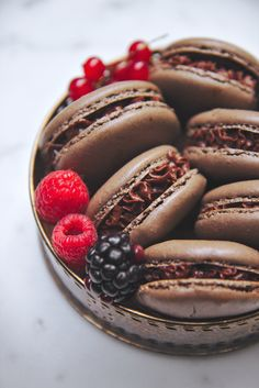Chocolate Italian macaron shells filled with sweet summer berry jam and bittersweet ganache—the fudgiest macarons ever!