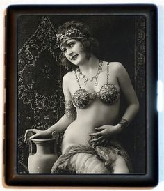 Cleopatra Egyptian Revival Style Nude Flapper Jazz Age Roaring 20s Style Six Cigarette Case Wallet Business Card Holder. $9.99, via Etsy.