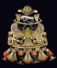 This piece of Ancient Egyptian jewelry is a rebus pectoral scarab worn by King Tut-ankh-amun from Thebes. It symbolizes the birth of the moon and the sun and was part of the king's coronation regalia.
