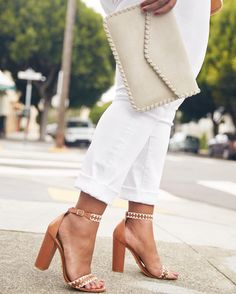 Good things come in threes! Take on spring in fresh white denim, strappy block heels & a cool clutch. #YouStyled