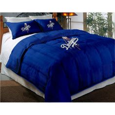 Los Angeles Dodgers Comforter Set: Twin Comforter with Shams by Northwest. $77.95. Chenille Embroidered Team Logos. Includes Two Shams. Comforter Filling 100% Polyester.. Sham & Comforter Shell 60% Cotton / 40% Polyester.. Add some team spirit to your favorite fans bedroom! Super cozy and super soft, right down to the large embroidered team logos that stand out from the solid background.  This comforter set features a soft, chenille embroidery on both the comfort...