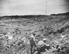 7th Infantry Division soldiers of the US 10th Army swarm into Yonabaru on the coast of Okinawa