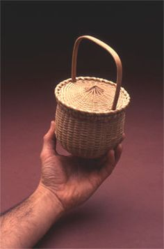 FEATHER BASKET WITH CAPTURED LID