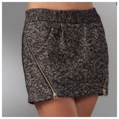 "Rebecca Minkoff Colette Tweed Zipper Mini Skirt Stylish mini skirt by Rebecca Minkoff. Size 6. Purchased thinking i would get it tailored & I never did. Accented by gold zippers. Back zip closure. Made out of cotton, wool, mohair & nylon. Silk lining. Front pockets. Top to bottom is about 13"". Across the top is just over 16"". NWT but the Nordstrom sticker was removed. No trades. Reasonable offers! Rebecca Minkoff Skirts Mini"