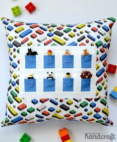 A pillow with pockets to stash some teeny Lego friends - love the matching Lego fabric!