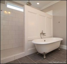 I like the wood wall rather than tile outside the shower