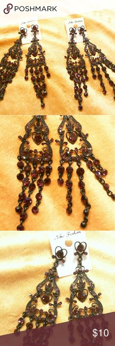 NWT beautiful wine/black statement earrings New with tags beautiful chandelier style hanging black and wine colored statement earrings add class and sophistication to any outfit new fashion Jewelry Earrings