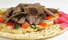 This is a shawarma this is one of the foods of the Emirati cuisine. its wrap that contains beef inside of it and other vegetables
