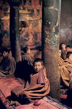 A young monk in a Tibetan Buddhist monastery,  Steve MCurry
