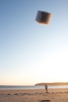 """This astonishingly light-weight cube is a fully flyable kite named """"Little Shining Man,"""" which is completely hand assembled with over 23,000 individual pieces. Conceived by Heather & Ivan Morison, designed by Sash Reading, and engineered by Queen & Crawford"""
