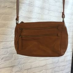 """Light brown purse Small light brown purse with three zippered openings. Cross body. Great condition. Two of the zipper tags are slightly faded. Strap has 5 holes, I keep it on the largest making it approximately 20"""" long. 10""""w x 8""""l x 2"""" d Forever 21 Bags Crossbody Bags"""