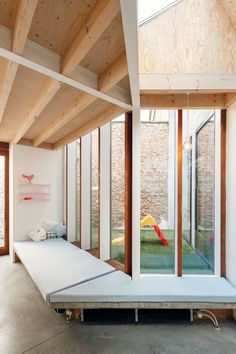 architecten Have Transformed a Row House into a Light-Filled Family Home - i.architecten Have Transformed a Row House into a Light-Filled Family Home 7 - Space Architecture, Architecture Details, Outside Flooring, Internal Courtyard, Arched Doors, House Extensions, Interior And Exterior, Home And Family, Window Seats