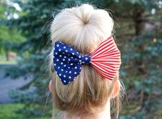 I love this patriotic bow! Pair it with high waisted denim shorts and a tank for the perfect 4th of July attire  via Red White and Blue American Flag Fabric Hair Bow Clip on Etsy, $7.00