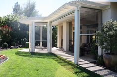 Watch the action from this lovely patio with retractable screens...