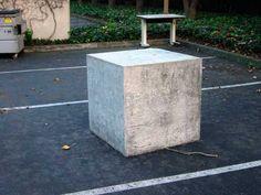 Key visual - concrete blocks run throughout.  Cold, hard, hostile surface.