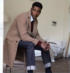 Wearing standout pieces by Mr P., Joshua Payne sports a houndstooth overcoat and Shetland wool sweater. He also models a white shirt and slim-fit selvedge denim jeans.