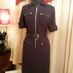 """Michael Kors military style dress Black military style dress with matching black belt strap with silver buckle. I'm 5'1"""" and it goes up to my knees. Goes great with black boots! The dress has long sleeves but roll up to a cuff with a strap to hold it in place. Michael Kors Dresses Long Sleeve"""