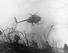 A Loach in the air above infantry. Vietnam.