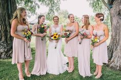 Bridesmaids wear individual rose coloured dresses | Photography by http://www.saralincolnphotography.co.uk/