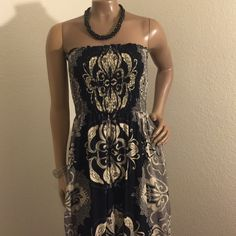 strapless maxi dress! Excellent condition, bought from Tilly's worn just twice, size s/m. Top is a tiny bit stretchy, fits great for small-medium size. Colors are black,gray and a bit of cream color Dresses Maxi