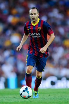 Andres Iniesta of FC Barcelona runs with the ball during the La Liga match between FC Barcelona and Levante UD at Camp Nou on August 18, 201...