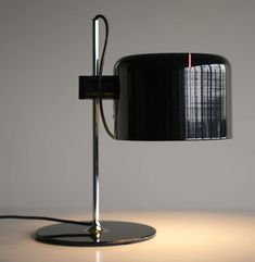 Joe Colombo for Oluce Coupe Table Lamp   From a unique collection of antique and modern table lamps at http://www.1stdibs.com/furniture/lighting/table-lamps/